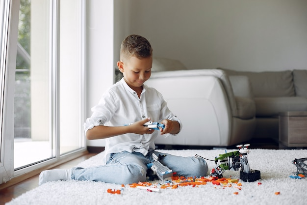 Child playing with lego in a playing room