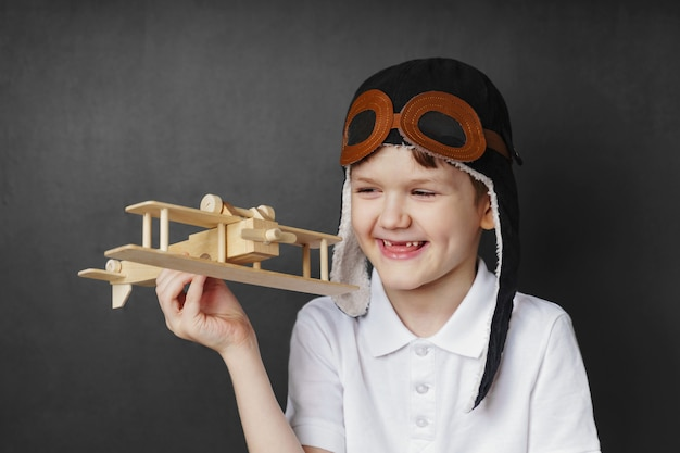 Child plays with a toy plane at home.
