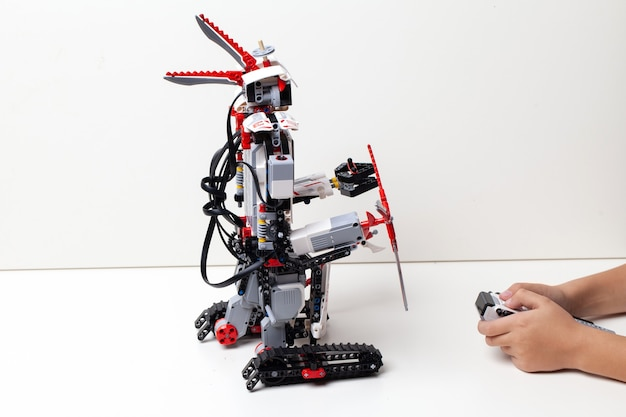 Child plays with a toy robot