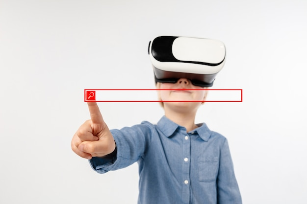 Child pointing to the empty search bar with vr-glasses isolated