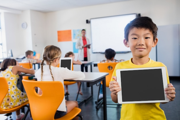 Child posing with a tablet