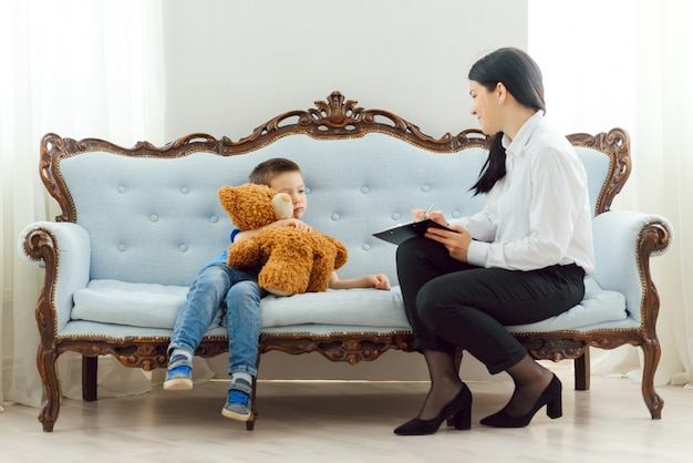 Child psychologist attending small boy