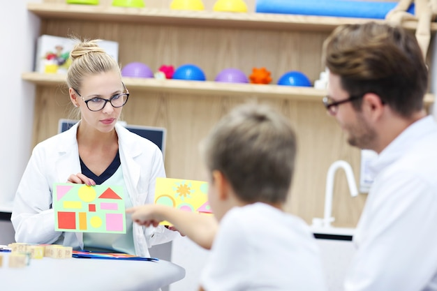 Child psychologist working with family in office