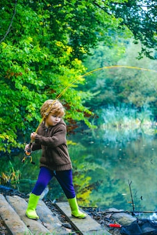 Child pulling rod while fishing on weekend.