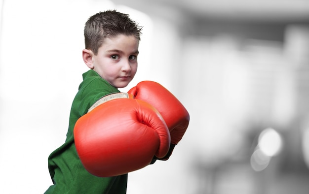 Child punching with boxing gloves