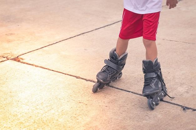 Child rollerblading