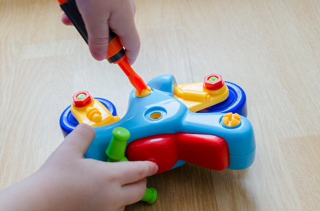 Child's hand with a toy