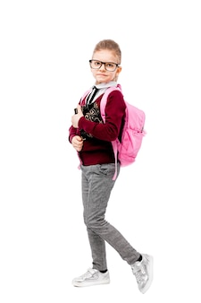 Child in school uniform with pink schoolbag