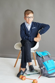 Child schoolboy in class