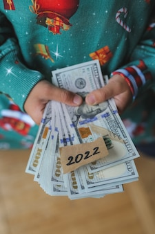 A child of seven is saving money for new purchases in 2022. new year 2022