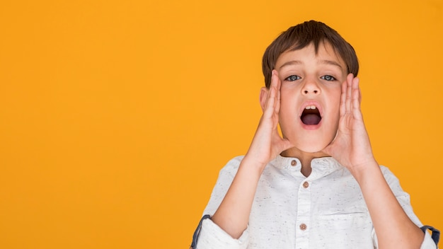 Child shouting with copy space