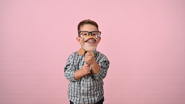Child shows mouth with magnifying glass. high quality photo