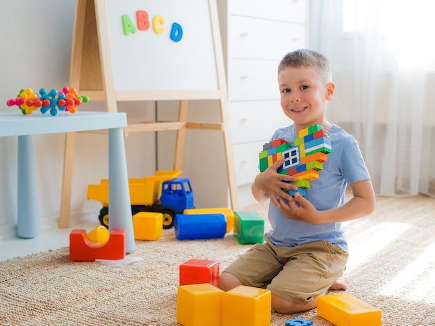 Child sitting on the floor in the room playing