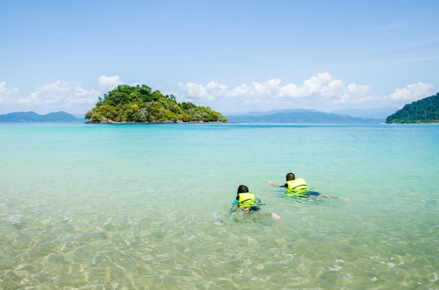 Child skin divers in the sea.