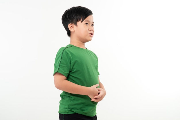 Child standing in profile having a severe stomach ache and screaming isolated on white
