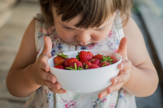 Child and strawberry