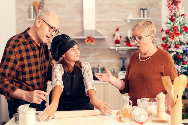 Child surprising grandparent on christmas day