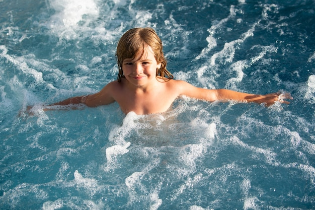 Child swimming. kids summer vacation in swimming pool.