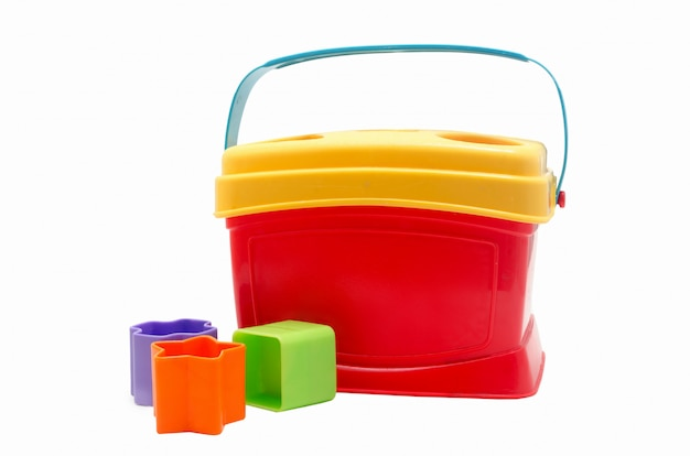 Child toy red bucket and multi-colored molds. child sorter