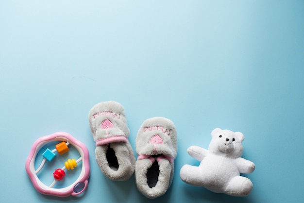 Child toys on blue. baby flat lay with copy space