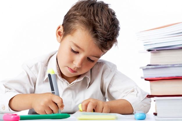 Child underlining the book