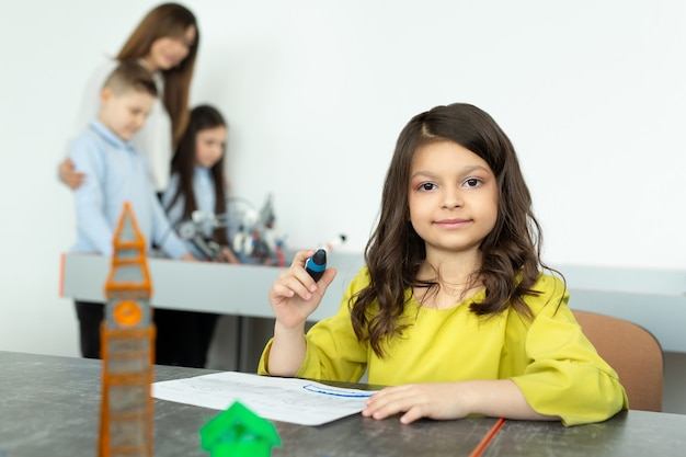 Child using 3d printing pen. girl making new item. creative, technology, leisure, education concept