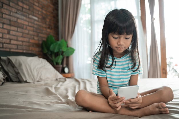 Child using smartphone at home