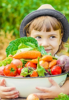 Child and vegetables on the farm. photo.