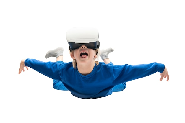 Child in virtual reality glasses soars isolated on white surface. virtual reality games, vr glasses.