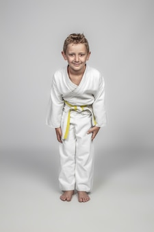 Child wearing martial arts judogi in the rei position
