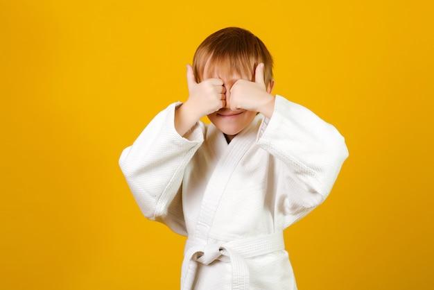Child wearing white kimono.