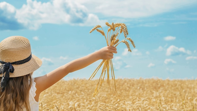 A child in a wheat field.