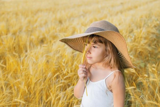 A child in a wheat field.