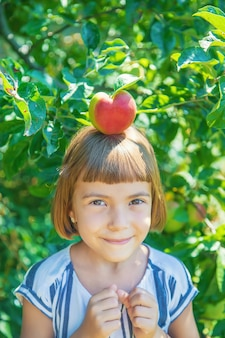 Child with an apple in the garden