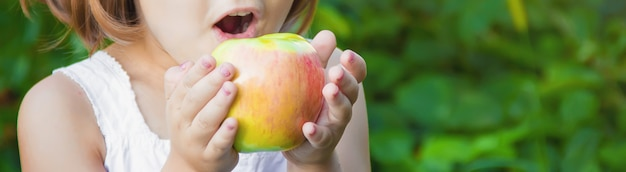 Child with an apple. photo. nature