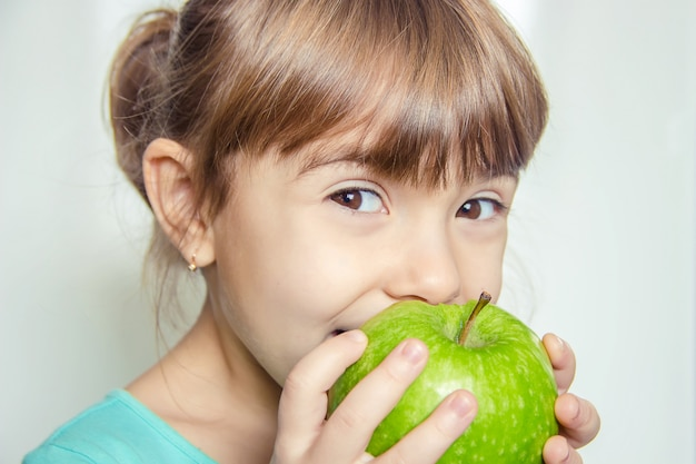 Child with an apple. selective focus. nature