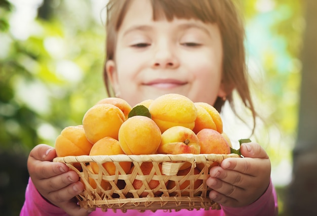 Child with apricots.