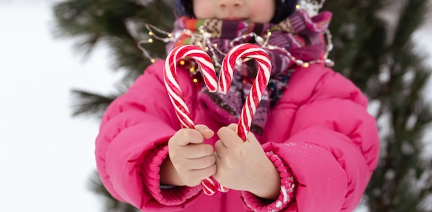 Child with a big candy canes. christmas concept.