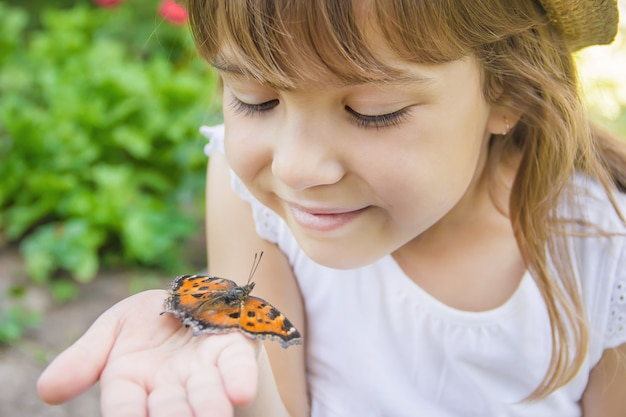 Child with a butterfly. idea leuconoe. selective focus.