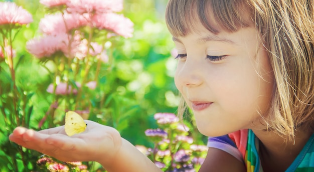 Child with a butterfly. selective focus. nature.
