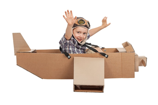 Child with cardboard airplane
