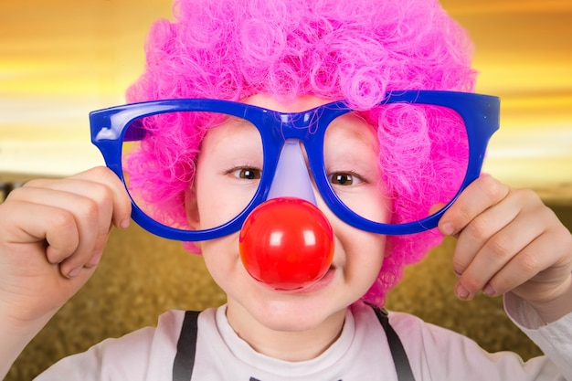 Child with clown glasses