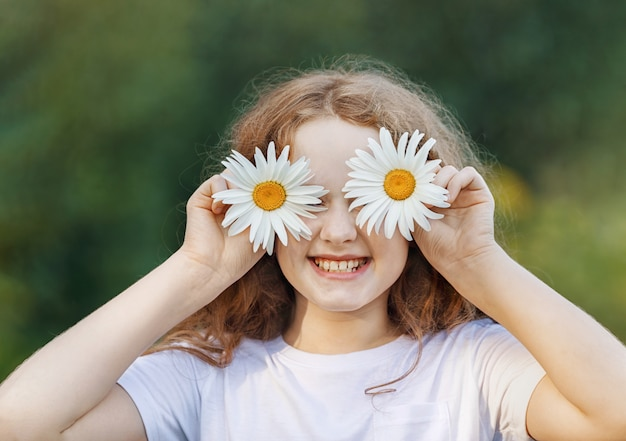 Child with daisy eyes showing white healthy  teeth