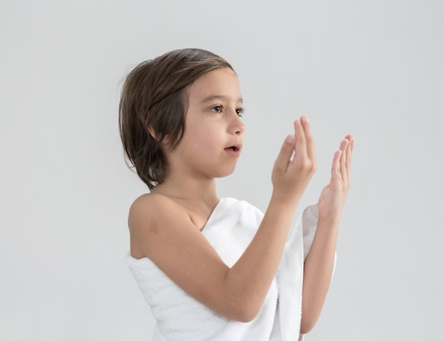 Child with hajj pilgrimage clothes praying