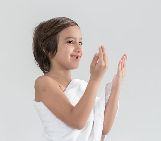 Child with hajj pilgrimage clothes praying