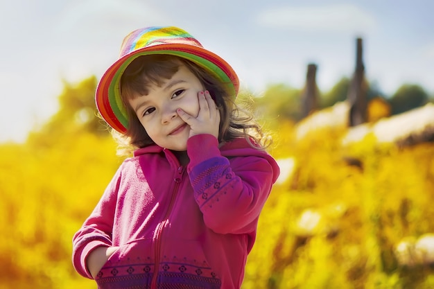 Child with hat in rural style