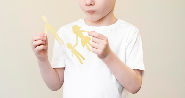 Child with paper family shape