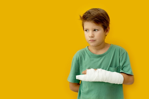 A child with a plaster on his hand. copy space.