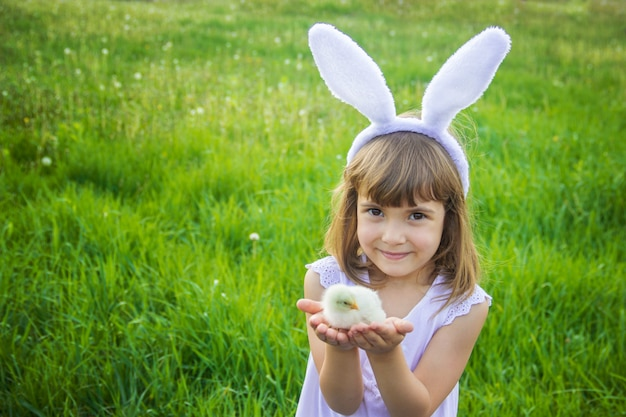 Child with rabbit ears. easter. selective focus.