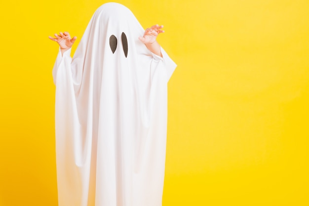 Childen with white dressed costume halloween ghost scary